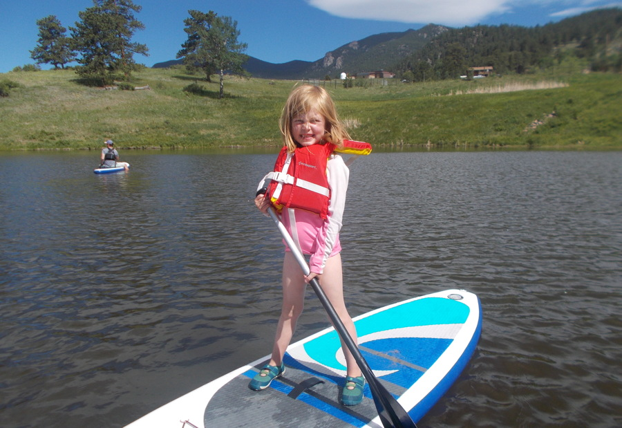 girl paddleboarding - avid4 adventure