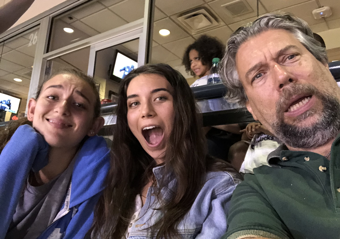 family mugging for selfie, coors field