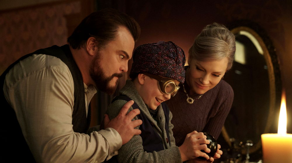 Jonathan (Jack Black), Lewis (Owen Vaccaro) and Mrs. Zimmerman (Cate Blanchett) The House with a Clock in its Walls