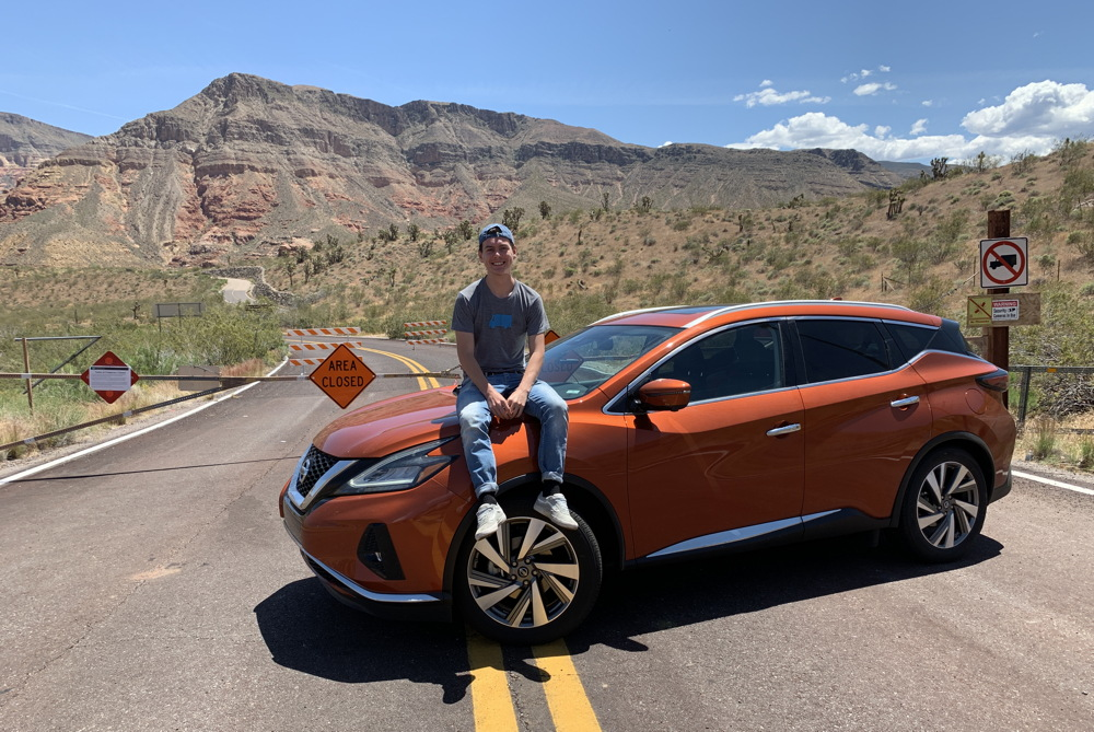 boy sitting on 2019 nissan murano awd - utah
