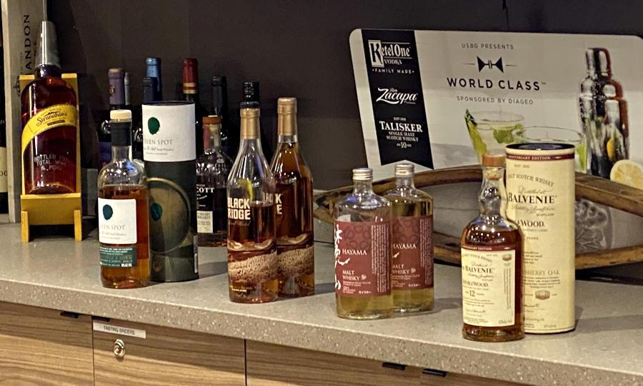four whiskeys - whiskey tasting samples - total wine