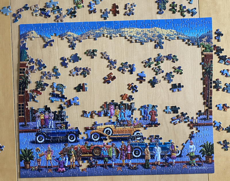 dowdle folk art jigsaw puzzle - hollywood - partially solved