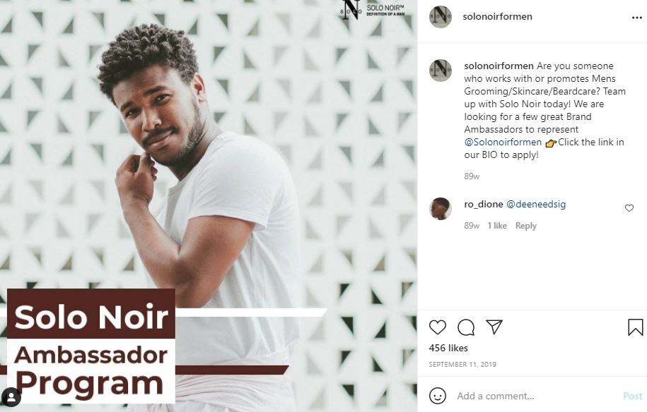 Screenshot of Solo Noir's Instagram post from September 2019 seeking applicants for their Ambassador Program, an influencer marketing campaign Go Getter worked on. The post shows a smiling Black man in a white t-shirt against a white tiled background, and has 456 likes.