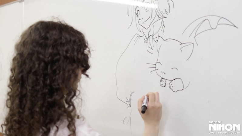 Mar drawing her manga characters