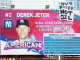 A brave and determined eco-activist jumped from the Target Field parking garage to the catwalk in right field to hang this Love Water Not Oil sign while Derek Jeter was at-bat during the 2014 MLB All-Star Game