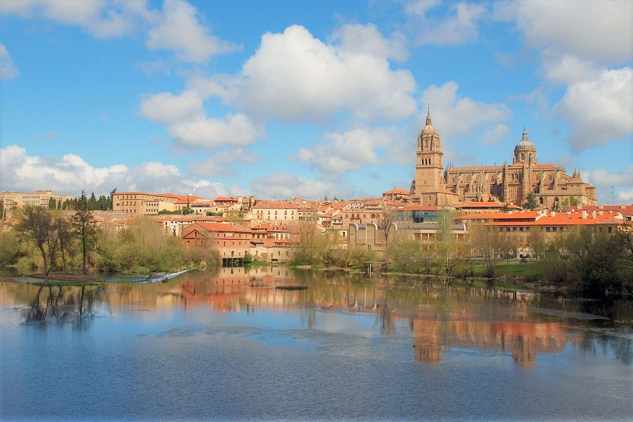 View of the streets and Cathedral of Salamanca, Spain, from across the river