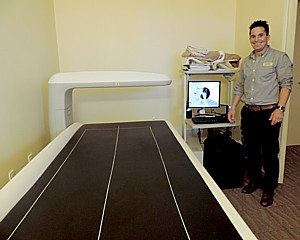 The DEXA scan machine will tell you the cold truth about body mass, fat and bone density, so that exercise physiologist Oliver Mendez can come up with an exercise and nutrition plan © 2015 Karen Rubin/news-photos-features.com.