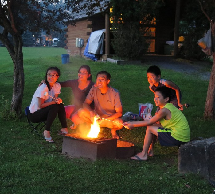 A family poses for a photo at their campfire at the Herkimer Diamond Mines KOA © 2015 Karen Rubin/news-photos-features.com