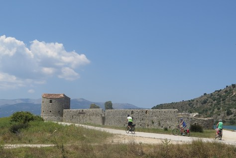 Riding by fortress en route to Butrint © 2016 Karen Rubin/goingplacesfarandnear.com
