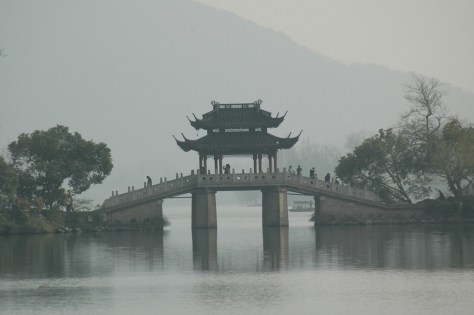 A bridge adds to the picturesque quality of West Lake, as charming as it was in Marco Polo's day. © 2016 Karen Rubin/goingplacesfarandnear.com
