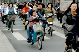 Braving the traffic: bikes and mopeds cram their lane on the streets of Hangzhou © 2016 Karen Rubin/goingplacesfarandnear.com