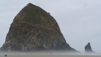 Haystack Rock with a foggy base