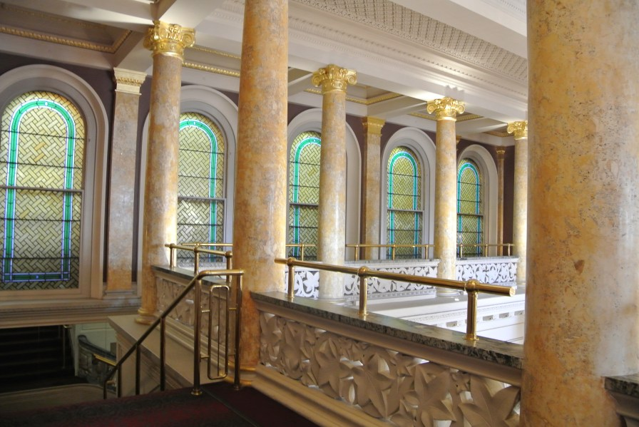 Beautiful gilded columns and stained glass windows flanking the balcony
