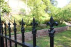 Wrought iron fence leading into Beau Jardin from the Roque House and Garden