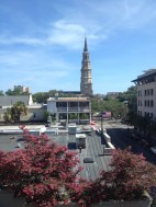The view of St. Philip's steeple and Charleston's Historic Rooftops from our window in the Luxury King Balcony Suite
