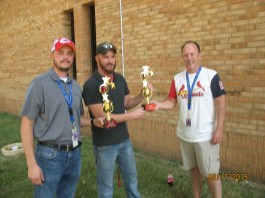 "Terry Basham presents the second place trophies to team ""Flying Steel."""