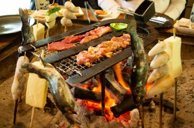 Charcoal grilling river trouts, taro, tofu, local chicken and local beef