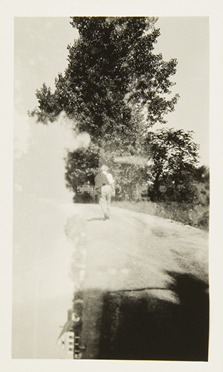 Man and Landscape [double exposure, possibly Stieglitz at Lake George], undated Unidentified photographer Black and white photograph 4 1/2 x 2 ¾ in. 2014.03.297