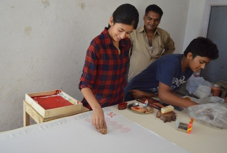 Devena's daughter Shivangali prints a paisley design.
