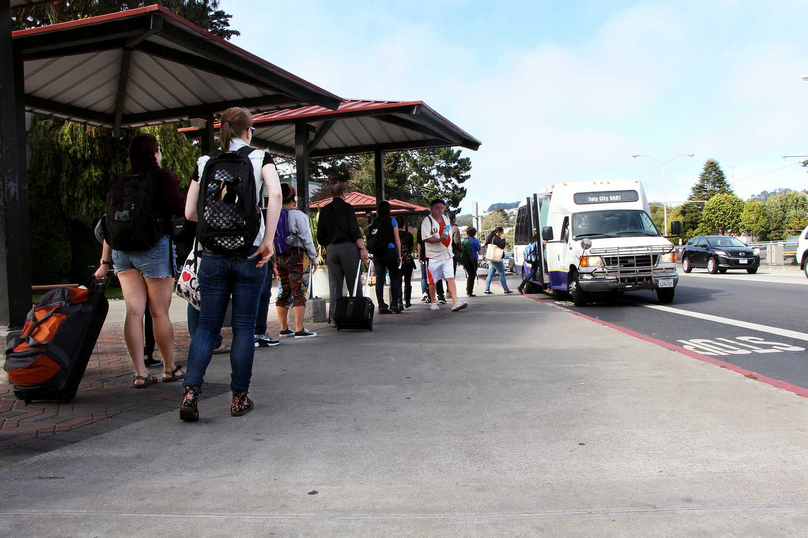 SF State students line up to take the free shuttle to the Daly City BART station on Thursday, August 29, 2013. The San Francisco Bay Bridge closure this week is creating traffic problems SF State students commuting to school across the Bay. Photo by Gavin McIntyre / Xpress
