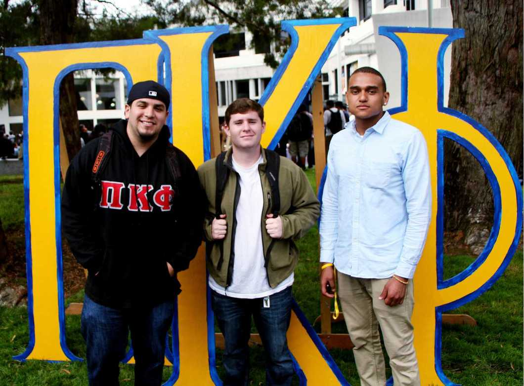 Members of Pi Kappa Phi pose next to Cesar Chavez Plaza on Thursday, August 28, 2013. The fraternity is recruiting new members as part of rush week. Photo by Gavin McIntyre / Xpress