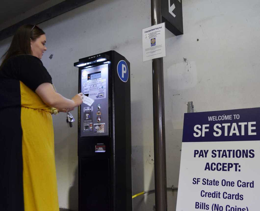 Stephanie Jacobs, a graduate student, pays for her parking fee with a credit card at one of the new parking machines in the SF State Public Parking garage on Sept. 6, 2013 in San Francisco, Calif. Photo by Amanda Peterson / Xpress