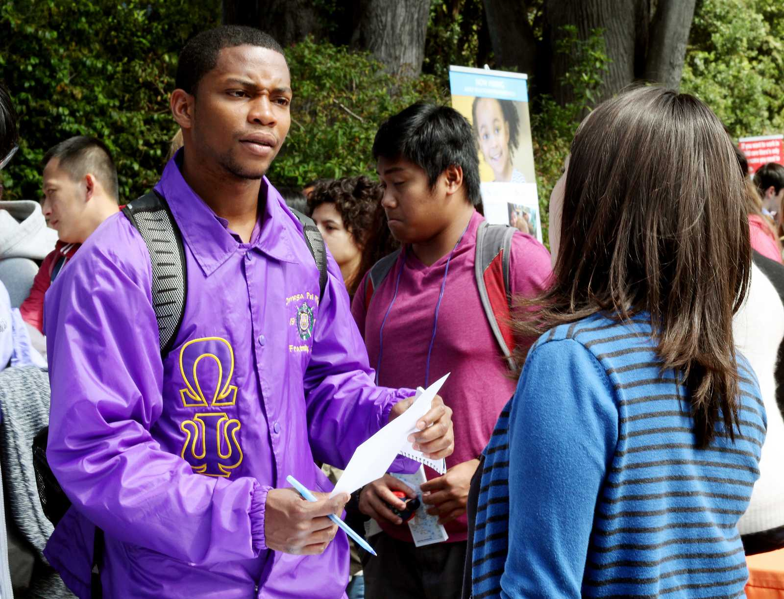 Shawn McGriff (left), a Liberal Studies major, speaks to Zoila Baltodano, the business office manager at Cesar Chavez Student Center, at a Part-Time Job Fair held in the quad at SF State, on Sept. 12, 2013. The event was put together by the Student Involvement and Career Center as a for students to meet on and off campus employers offering part-time positions. Photo by Gavin McIntyre / Xpress