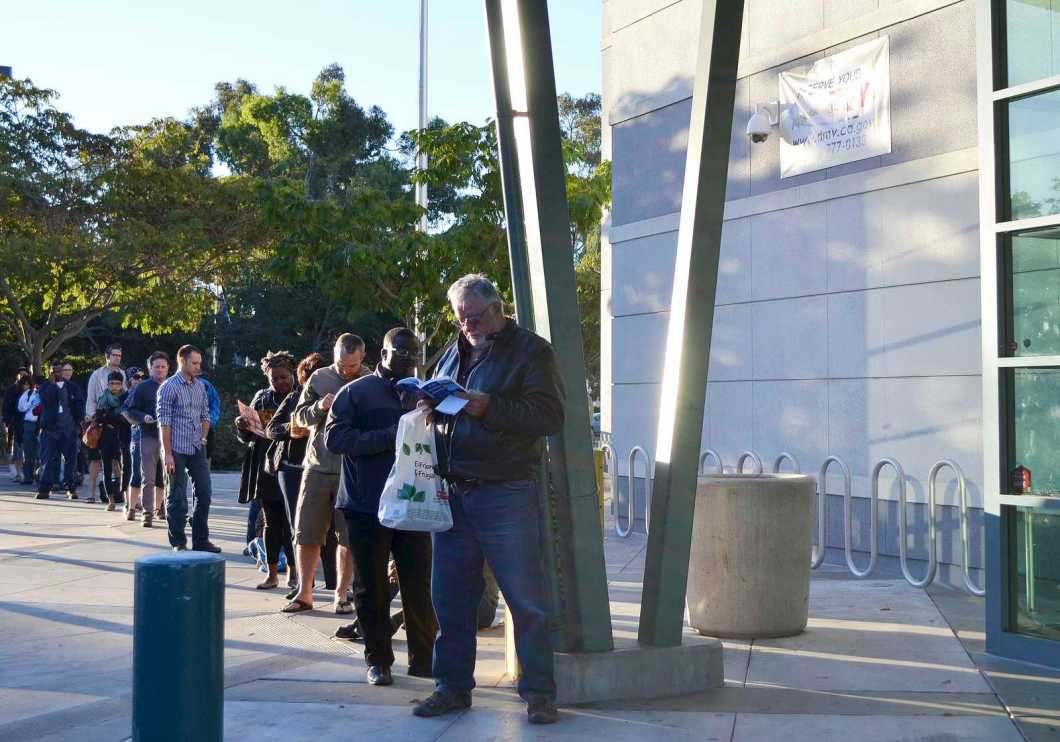 People stand in line at the Claremont DMV waiting for the doors to open at 8 a.m. Monday, Sept. 23, 2013 in Oakland, Calif. Photo by Amanda Peterson / Xpress