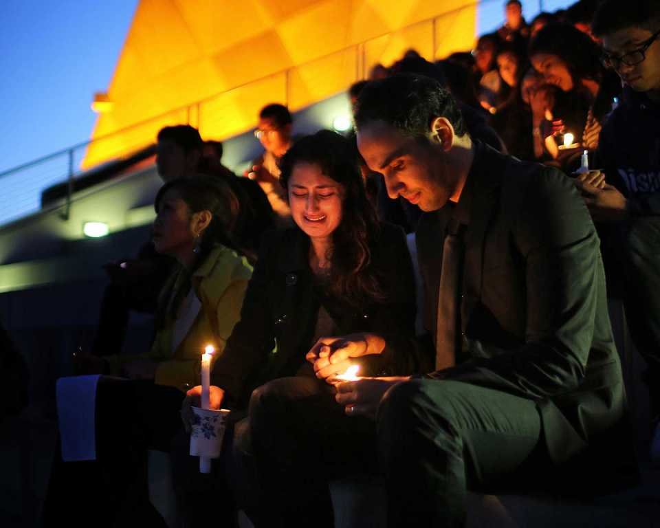 Jessica and Nizar Labidi, sister and brother-in-law of Justin Valdez, attend the candlelight vigil on top of the Cesar Chavez Student Center at SF State for Valdez on Thursday, Sept. 26. Valdez was a SF State student who was shot and killed on Sept. 23 as he got off of the M-Oceanview train in Ingleside. Photo by John Ornelas / Xpress