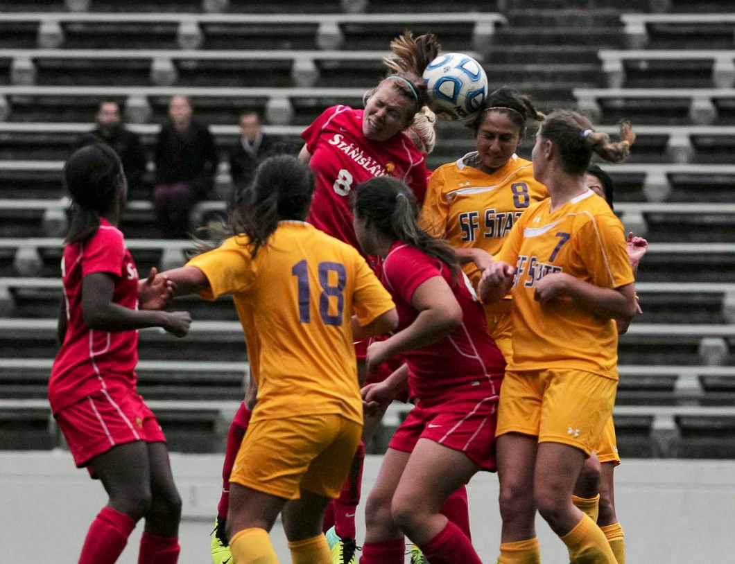 SF State's Brittany Oldham(8) and Cal State Stanislaus' Apryl Whitney(8) compete for a header during the game at Cox field at SF State, Sunday, Oct. 20, 2013. The game ended in a scoreless tie, 0-0. Photo by Amanda Peterson / Xpress