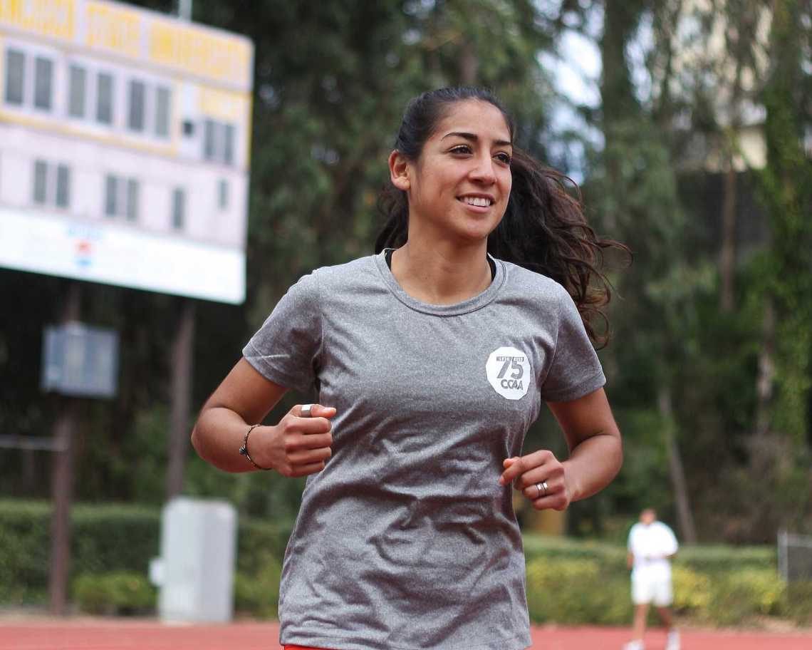 Zuleima Bernal, a senior, runs the track at Cox Stadium on Tuesday, Oct. 29, 2013. Bernal has recently returned to compete after her case of plantar fasciitis caused her to miss most of the season. Photo by Ryan Leibrich / Xpress