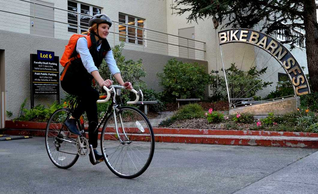 Laura Melroy 25-years-old a grad student biology major (MS ecology evolution conservation) rides out of the Bike Barn at SF State towards the nearest bike path, Thursday, Oct. 31, 2013. Four new sustainability courses are coming to SF State, one of them is called Bicycle Geographies starting in the Spring of 2014 about alternative transportation, bicycles and bike paths and more. Photo by Amanda Peterson / Xpress