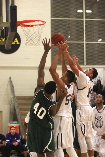 SF State Gators Erik Fearn (54) and Will Overton, Jr.(15) and Cal Poly Pomona Bronco Jordan Faison (40) jump for a rebound during the men's basketball game at The Swamp Tuesday, Feb. 15. Photo by Tony Santos / Xpress