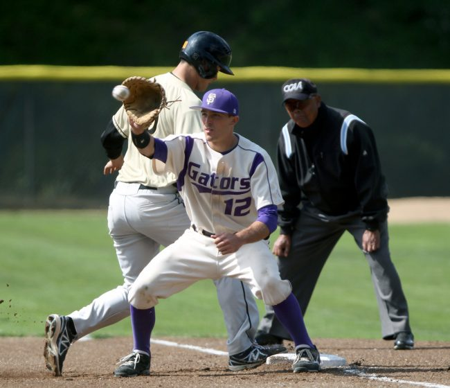 SF State's Garrett Heisinger is late to catch the ball as Cal State L.A. Manny Acosta makes it back to first during the Gators game against the Golden Eagles, at SF State's Maloney Field Sunday, April 13. Photo by Gavin McIntyre / Xpress