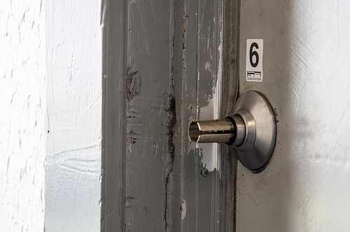 The door handle of the apartment where Stephen Guillermo was shot and killed Saturday, May 3. Photo by Jessica Christian / Xpress