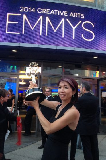 SF State alumna Chikako Suzuki poses with her award in front of Nokia Theater in Los Angeles at the 2014 Creative Arts Emmys, Aug. 16. Holiday Landa / Special to Xpress.
