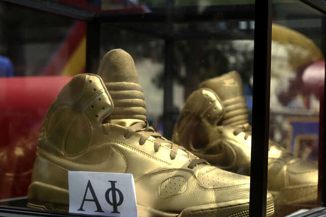 Golden shoes sit in a glass box at The 3rd Annual Kick Off presented by ASI held the event at Cesar Chavez Plaza at SF State Thursday, September 4, 2014 in San Francisco, Cali.