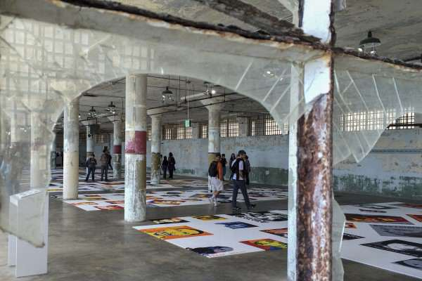 "Alcatraz visitors observe Ai Weiwei's ""Trace"", an art installation of over 175 portraits made entirely of LEGO, each face depicting a subject of political detainment, Saturday, Sept. 27, 2014. Jenna Feeley / Xpress."