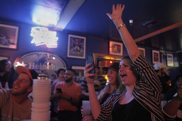 Shannon Conklin, a senior Broadcasting and Electronic Communication Arts major, cheers for the Giants while watching Game 1 of the World Series against the Kansas City Royals in the Pub at SF State Tuesday, Oct. 21, 2014. Daniel Porter / Xpress.