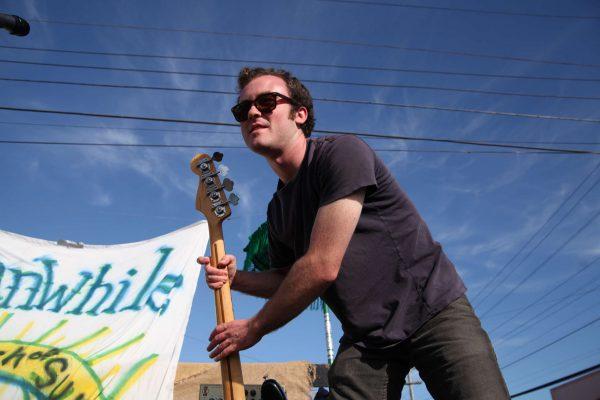 Joey Buttitta puts away his bass after his band, Talk of Shamans, finish their set Saturday, Oct. 11, 2014. Lorisa Salvatin / Xpress.