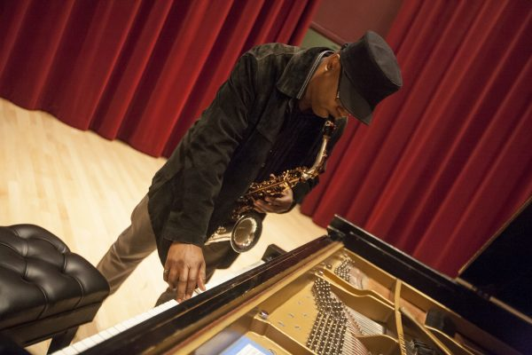 Renowned jazz saxophonist, Greg Osby, tunes his instrument before conducting a jazz master class in Knuth Hall Wednesday, Oct. 15, 2014. Martin Bustamante / Xpress.