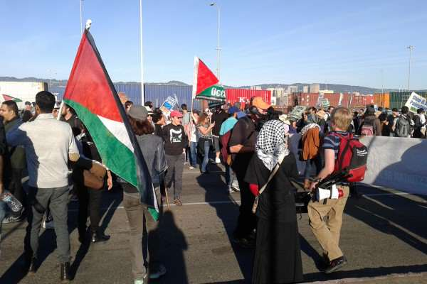 Pro-Palestinian demonstrators protest in front of the Port of Oakland shipyard in an effort to block Israeli cargo company Zim Integrated Shipping Services Ltd. Sunday, Oct. 26, 2014. Alma Villegas/Xpres.