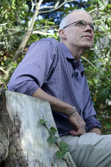 "Bill McKibben, author and environmentalist, poses for a photo after his lecture on ""Updates From the Front Lines of the Climate Fight"" at McKenna Theatre at 2 p.m. Thursday, Oct. 16, 2014. Amanda Peterson / Xpress."