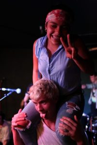 SF State freshman, Ruby Felix, posed for a picture on the shoulder's of Hot Flash Heat Wave's Adam Abildgaard, after their set Thursday, Oct. 16, 2014.. Lorisa Salvatin / Xpress.