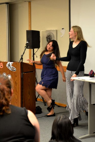 Wednesday, October 29th, Students gathered in the Rosa Parks conference room to take part in the Educational and Referral Organization workshop for sexuality, kink and bondage Wednesday, Oct. 29, 2014. Here, professional kinkster, Shay Tiziano (right) instructs her assistant Jade Taylor to remove her panties, so that they can be stuffed into her mouth as a makeshift gag. Helen Tinna/Xpress.