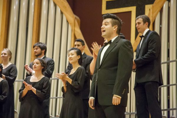 Jonathan White solos in the University Chorus's performance at the 13th annual Harvest Concert in Lakeside Presbyterian Church Friday, Nov. 14, 2014. Martin Bustamante/Xpress.