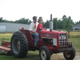 Carter driving Pops tractor
