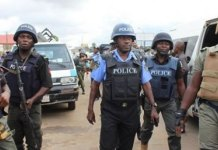 policemen prevent hoodlums from looting warehouse