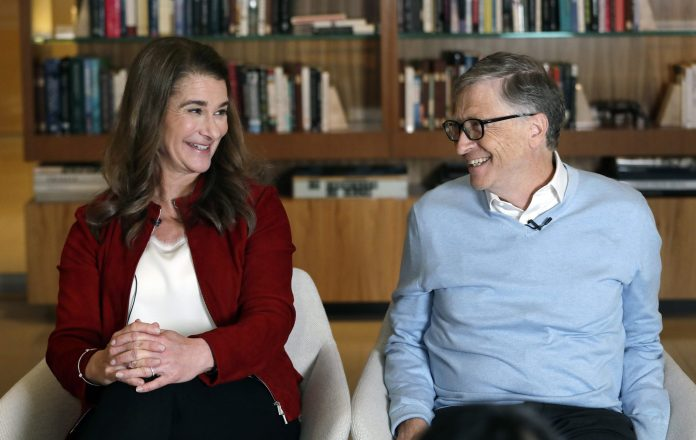 Bill and Melinda Gates look toward each other and smile while being interviewed in Kirkland, Wash. Associated Press