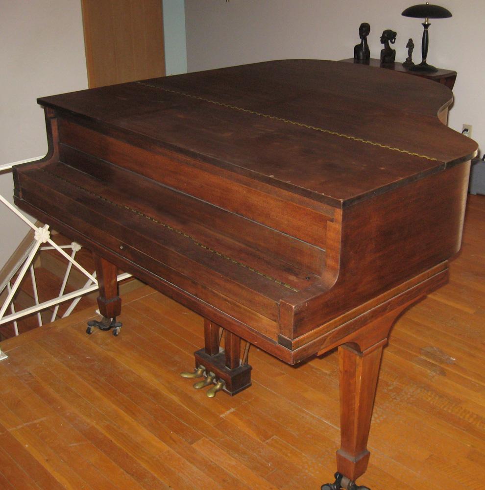baby grand golden piano